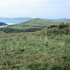 Looking towards the end of the headland. On the right is the first of two Bronze Age barrows.
