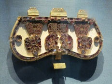 An ornate purse lid - would have originally covered a leather pouch which hung at the waist.