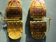 These ornate shoulder clasps are one of kind in Europe and were originally used to hold together the two halves of a stiff leather cuirass so it can fit the torso snugly in the Roman style.